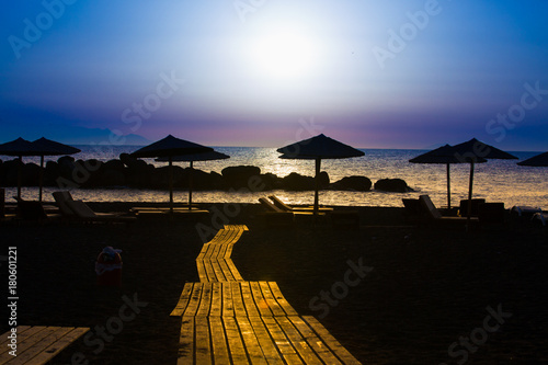 Juliste Wooden pavement on the beach at sunset time