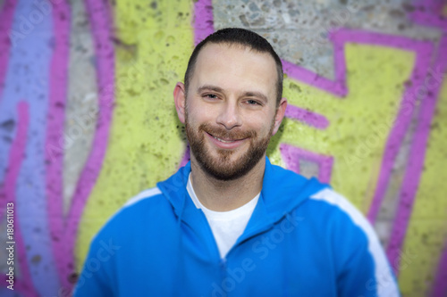 Foto op Plexiglas Graffiti young man at a graffiti wall