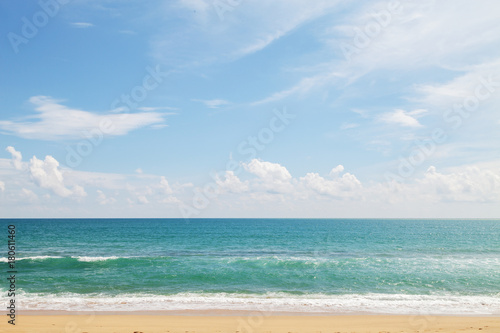 Fotobehang Thailand tropical andaman seascape scenic off beach in phuket thailand with wave crashing on sandy shore.