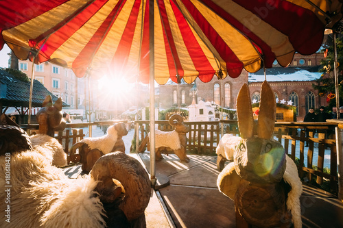 Foto op Aluminium Amusementspark Vintage Old Carousel On Christmas Market On The Dome Square In R