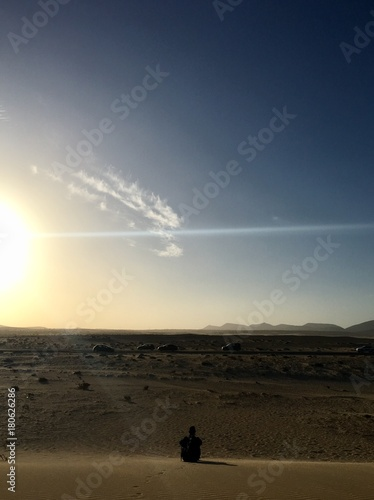 Foto op Canvas Canarische Eilanden sitting in Dunes of Corralejo, Canary islands, Spain