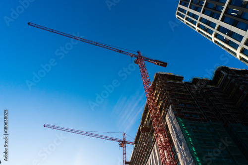 Foto op Canvas Texas Modern glass skycrapers background with sky and clouds reflection. Constraction.