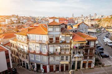 CItyscape view with beautiful old buildings during the sunset light in Porto city, Portugal