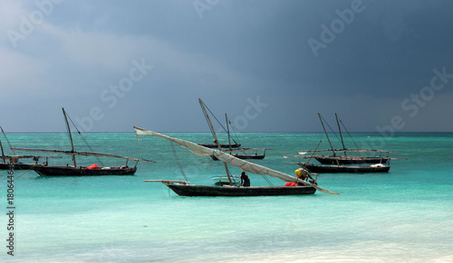 Tuinposter Zanzibar Traditional wooden sailing boats in Africa. Dhow.
