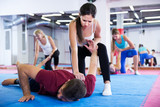 Fototapety Girl is doing self-defence moves with coach
