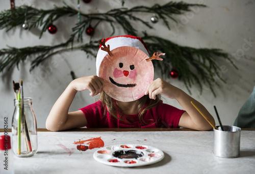 Little girl wearing a reindeer mask