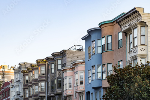 Plexiglas San Francisco Sunset light shines on a row of colorful buildings on Filbert Street in San Francisco, California