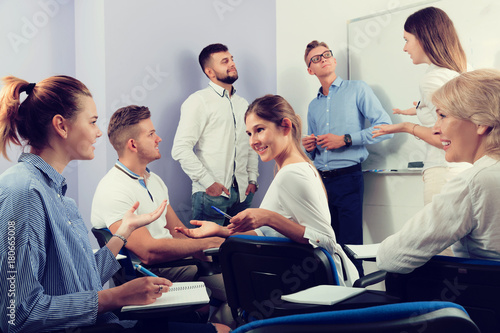 students talking with teacher and with each other - 180665008