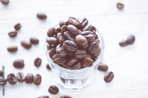 Top view of coffee beans with glass shot. vintage color effected