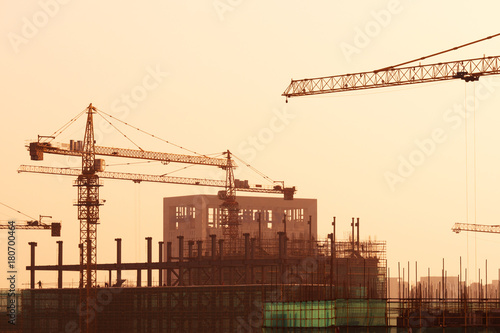 new construction site in modern city with sunbeam Poster