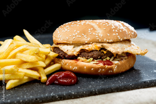 Fototapeta Cheese burger - American cheese burger with Golden French fries