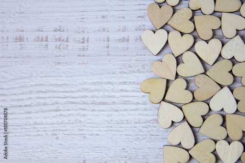 Tuinposter Brandhout textuur Heart shape from natural tree. Lovely heart shape by wooden small hearts on rustic wood table. Love theme concept with wooden hearts for Valentine's background and love theme.wooden leters i love you.