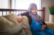 A pregnant woman from Asia live in Canada pose inside her house