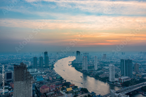 Poster Bangkok Aerial view of Bangkok cityscape with Chao Phraya river at sunset