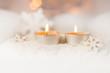 Leinwanddruck Bild - Zwei brennende Teelichte im Schnee