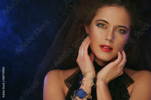 beauty and people concept: young woman with bright make up, clos Plakat