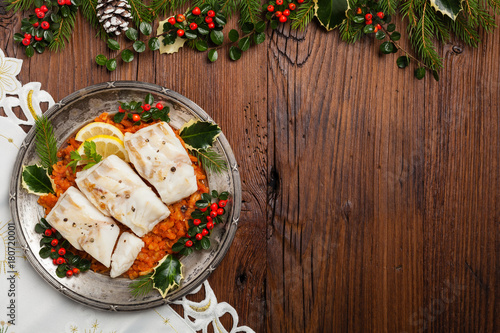 Christmas fish. Roasted cod pieces, served in vegetable sauce. - 180720001