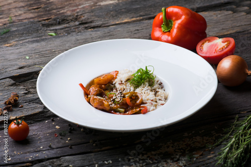 rice chicken on a wooden background - 180722233