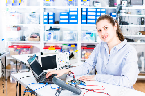Young woman in electronics repair service center Poster
