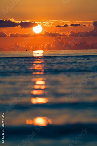 Foto op Canvas Zee zonsondergang orange sunset on sea, vertical