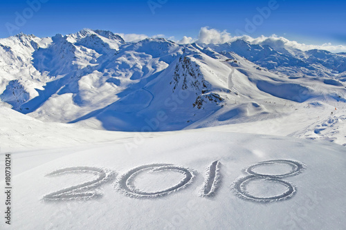 Fotobehang Bleke violet 2018 written in the snow, mountain landscape in the background