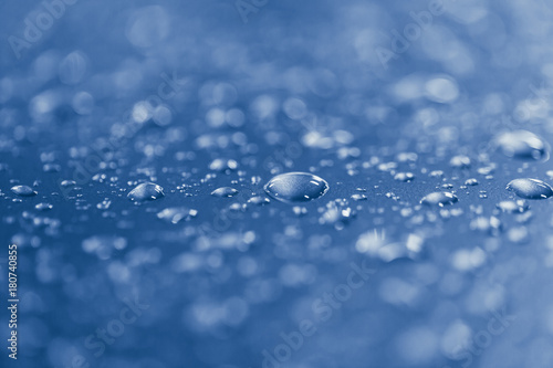Foto op Canvas Zen closeup blue rain water drops shallow depth of field
