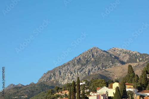Tuinposter Blauw Blue sky of Provence against the foot hills of the Alps