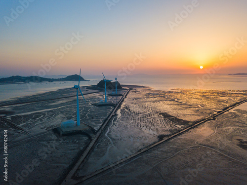 Aerial view Sunset of wind turbine in Daebudo Island,South Korea Poster