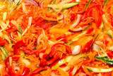 The process of cooking vegetable stew. Macro photography, close-up. Different vegetables. Colorful. Stewing in a frying pan. - 180744689