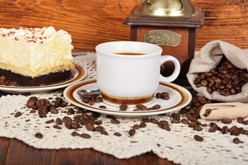 black coffee in a cup with chocolate cake