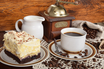 black coffee in a cup with chocolate cake © Kinga