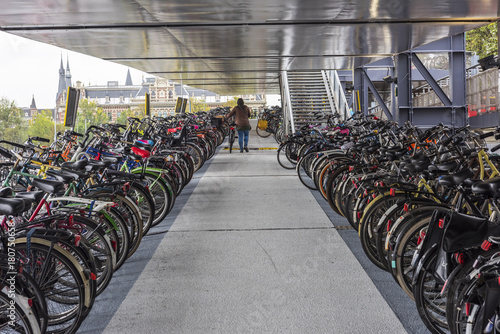 Foto op Canvas Amsterdam AMSTERDAM, NETHERLANDS - SEPTEMBER 24, 2017: Parking of bicycles in Amsterdam city. Amsterdam, Netherlands..