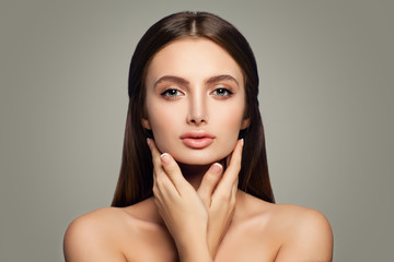 Young Healthy Woman, Skincare Concept. Clear Skin and Hands with French Manicure