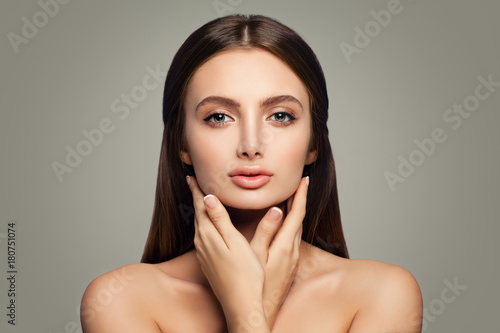 Fotobehang Spa Young Healthy Woman, Skincare Concept. Clear Skin and Hands with French Manicure