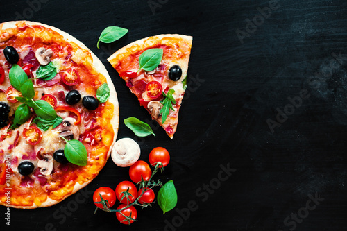 Papiers peints Pizzeria Pizza slice with Pepperoni, melting cheese and olives served at a pizzeria or restaurant
