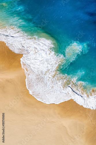 Papiers peints Tropical plage Aerial view to tropical sandy beach and blue ocean