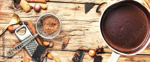 Foto op Canvas Chocolade Melting chocolate in a metal bowl