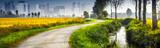 paesaggio di campagna con la città sullo sfondo - 180765402