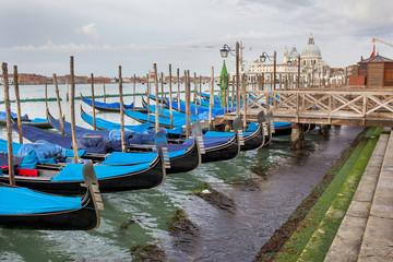 Venetian gondola and Cathedral of Santa Maria del Salute in Venice Italy