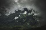 Dark, cloud shrouded landscape and mountain range - 180770662