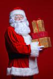 santa holding gifts - 180774428