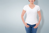 Shirt design and people concept - close up of woman in blank t-shirt front isolated. Clean empty mock up template for design. - 180778636