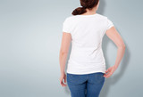 Shirt design and people concept - close up of woman in blank t-shirt rear isolated. Clean empty mock up template for design. - 180778642