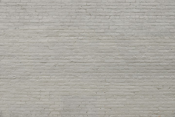 Old grey brick wall background texture