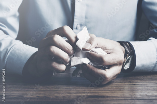 man hand crumpled paper
