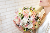 wedding bouquet in hands of the bride.