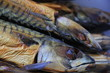 Smoked mackerel on market stall