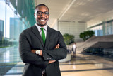 African american bank manager owner ceo business man standing confidently with pride in financial building - 180802852