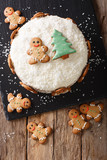 Christmas sweet cake with cheese cream and gingerbread close-up. Vertical top view - 180814871