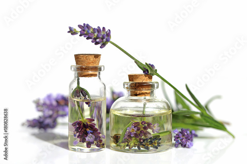 In de dag Spa Lavender oil. Oil with lavender flower in a glass small bottle and sprigs of lavender on a white background. Botanical cosmetics concept